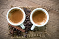Coffee cup and coffee beans on old wooden background Royalty Free Stock Image