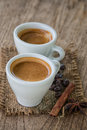 Coffee cup and coffee beans on old wooden background Stock Images