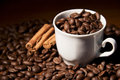Coffee cup with coffee beans time a and cinnamon Royalty Free Stock Photography