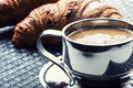 Coffee cup of coffee stainless steel cup of coffee and two croissants coffee break business break breakfast with Stock Image