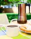 Coffee cup with cookies and moka pot outdoors Stock Photos