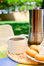 Coffee cup with cookies and moka pot outdoors Royalty Free Stock Image