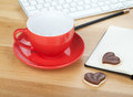 Coffee cup, cookies and office supplies Stock Image