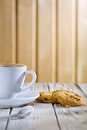 Coffee cup and cookies on old white table Royalty Free Stock Images