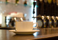 Coffee cup on a counter in a bar Royalty Free Stock Photo