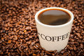 Coffee cup drink on beans Stock Photography