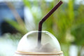 Coffee cup and drinking straw closeup Stock Photos