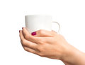 Coffee cup in female hand isolated on white Royalty Free Stock Photo