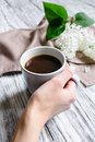 Coffee cup in a female hand Royalty Free Stock Photo