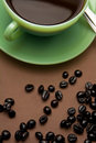 Coffee cup freshly made hot and some roasted beans Royalty Free Stock Photo