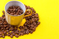 Coffee cup full of coffee beans Royalty Free Stock Photo