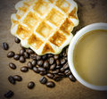 Coffee cup and grain with waffle Royalty Free Stock Images
