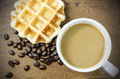 Coffee cup and grain with waffle Royalty Free Stock Photos
