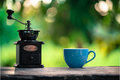 Coffee cup and grinder Stock Photos