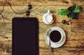 Coffee cup, headphones, flower pot, tablet, jug of milk Royalty Free Stock Photo