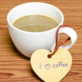 Coffee cup with heart tag write I love coffee word Royalty Free Stock Photo