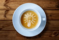 Coffee cup ideas with light bulb idea in the froth concept for creativity and innovation Royalty Free Stock Photos
