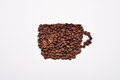 Coffee cup image made up of coffee beans on white background Royalty Free Stock Photo