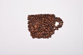 Coffee cup image made up of coffee beans on a white background Royalty Free Stock Photo