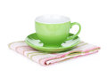 Coffee cup on kitchen towel isolated on white background Royalty Free Stock Image