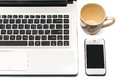 Coffee cup with laptop and cell phone isolated on white background Stock Photos