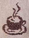 Coffee cup made of beans on burlap background roasted bag Stock Images