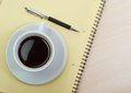 Coffee cup with note book Royalty Free Stock Image