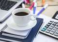 Coffee Cup at Office with Financial Papers,Agenda and Calculator Royalty Free Stock Photo