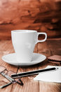 Coffee cup and office supplies on old wood table see my other works in portfolio Royalty Free Stock Photos