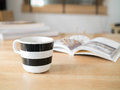 Coffee cup and open book on a desk Royalty Free Stock Photo