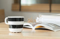 Coffee cup and open book with dried flower Royalty Free Stock Photo