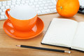 Coffee cup, orange fruit and office supplies Stock Image
