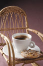 Coffee cup over rocking chair studio shot of Royalty Free Stock Image