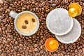 Coffee cup placed on a bed of coffee beans with capsules Royalty Free Stock Photo