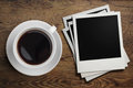 Coffee cup and polaroid photo frames on table Royalty Free Stock Photo