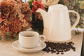 Coffee cup and pot on marble table Royalty Free Stock Photo