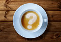 Coffee cup questions with question mark in the froth concept for problems uncertainty and asking Stock Photos