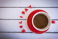 Coffee cup with red clay text on wooden table Royalty Free Stock Photo