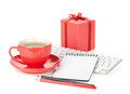 Coffee cup red gift box and office supplies isolated on white background Royalty Free Stock Photos