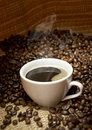 Coffee cup with roasted beans Royalty Free Stock Photography