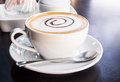 Coffee cup and saucer on black table Stock Images