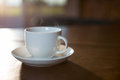 Coffee cup with saucer on a table Royalty Free Stock Photo