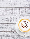 Coffee cup and saucer on white wood background Stock Photography
