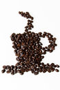 Coffee cup shaped figure made out of coffee beans against white background Royalty Free Stock Photo