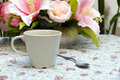 Coffee cup with spoon on the table colourfull flower Royalty Free Stock Photos