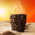 Coffee cup with steam on jute bag Royalty Free Stock Image