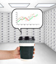 Coffee cup with stock chart Royalty Free Stock Photo
