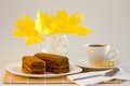 Coffee cup and sweet cake with autumn leaves Stock Photo