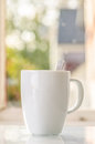 Coffee cup on table nature in background Stock Photos