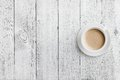 Coffee cup top view on white wood table background Royalty Free Stock Photo